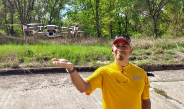 Photo of Jose with a drone hovering just above his hand.