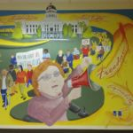 A 10ft x 12ft mural of Judy Heumann in front of the state capitol.